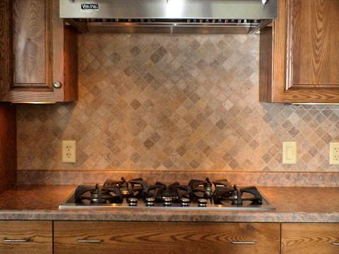 Add dimension with a unique backsplash for your stove or sink.