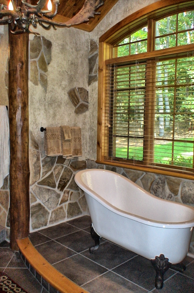 stone bathroom with clawfoot tub
