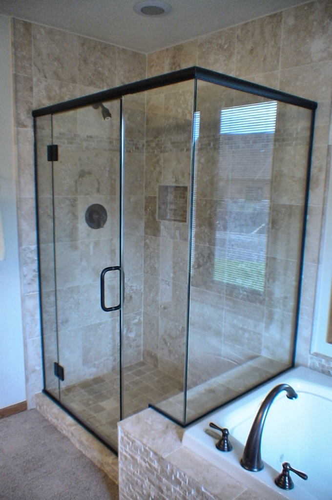 Two sided glass shower enclosure